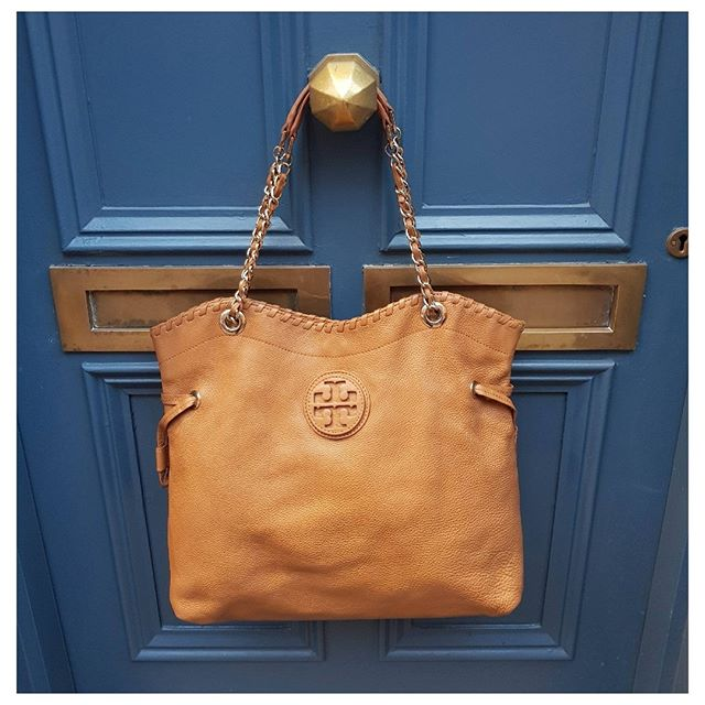 5c454370c2 Make this beautiful Tory Burch Drawstring Hobo your new companion to help  you tackle a busy